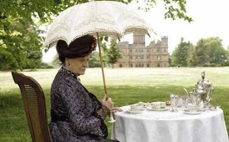 Violet Crawley, played by Maggie Smith, sitting with her silver teaware for an afternoon tea.