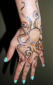 Maryam's hand painted with an image of a procul