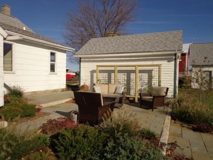 New bluestone patio with trellis in background
