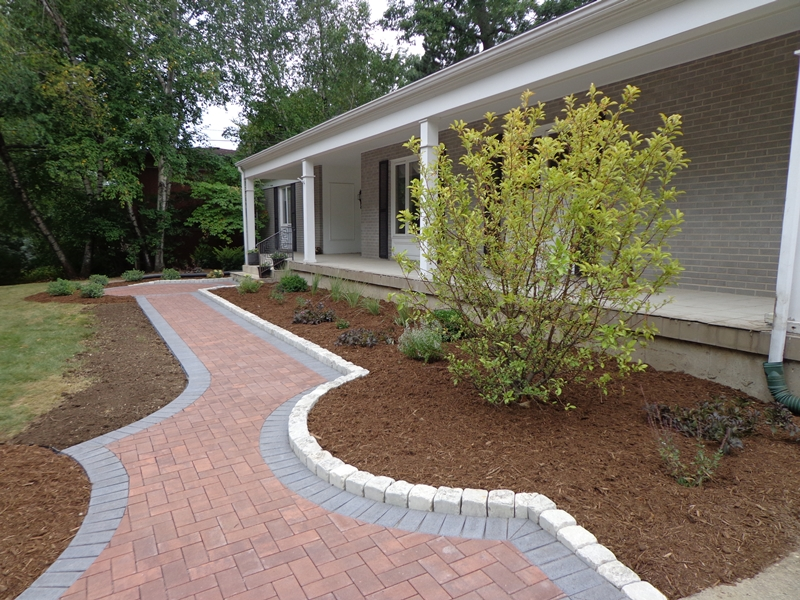 Front entry concrete paver walkway during landscape renovation