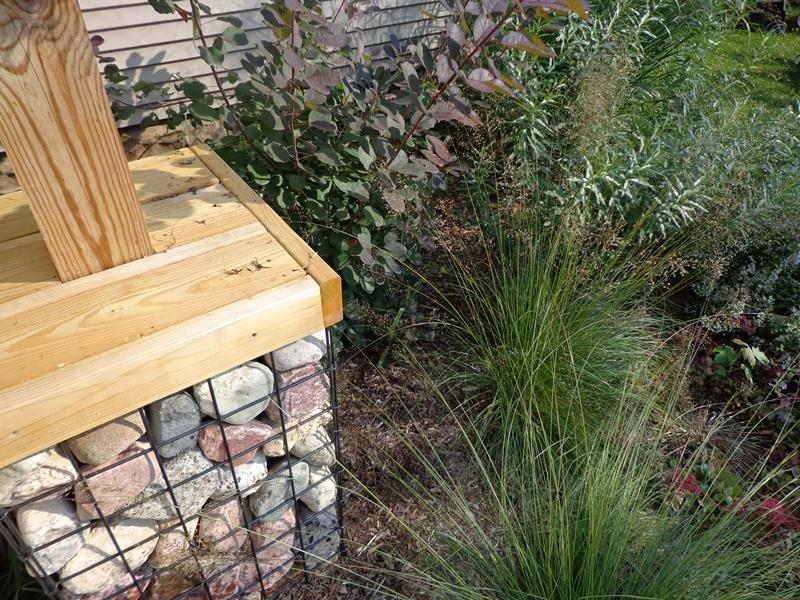 Gabion basket next to perennials