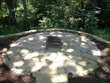 New flagstone patio with perennial border