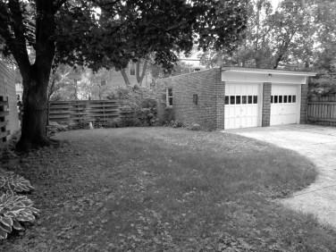 Shaded Flagstone landscape renovation before photo