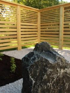 specimen boulder in front of trellis