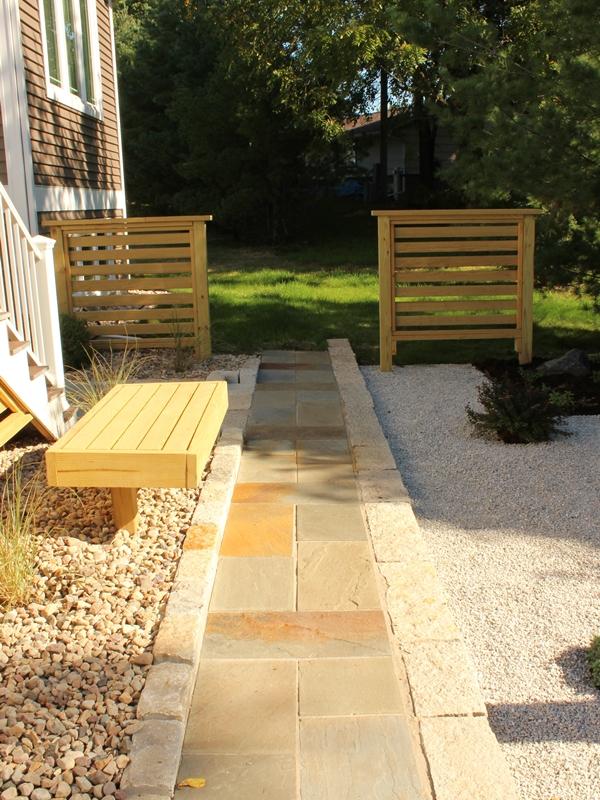 Bluestone walkway with trellis on either side