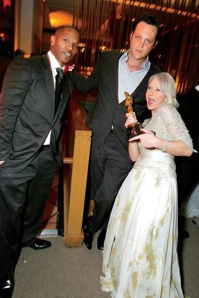 Jamie Foxx, Vince Vaughn, and Helen Mirren, with her Oscar for *The Queen,* 2007.