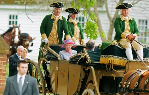 A conveyance to which she's quite accustomed: the Queen gets around Colonial Williamsburg in a saffron-fringed carriage, replete with tricorn-hatted footmen. Not unlike her ride after the royal wedding—except in America, those guys are *actors.* *By Heather S. Hughes/Newport News Daily Press/MCT via Getty Images.*