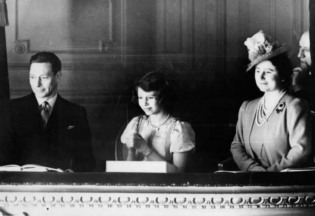 Princess Elizabeth with her parents, King George VI and Queen Elizabeth, in a box at the London Coliseum theater, March 1939.    From Keystone/Getty Images.