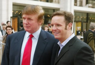 """Trump, shown here, in 2003, with *Apprentice* producer Mark Burnett, experiments with white roots and light filaments wrapped around the back of his head. Historians call this developer's """"middle-aged club kid"""" phase."""