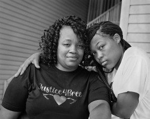Breonna Taylor's Mother, Tamika Palmer, and Sister, Juniyah Palmer, Standing at the Banister Where Breonna Once Stood, Near the Front Steps of Her Apartment on Springfield Drive in Louisville, Kentucky.Photographs by LaToya Ruby Frazier.