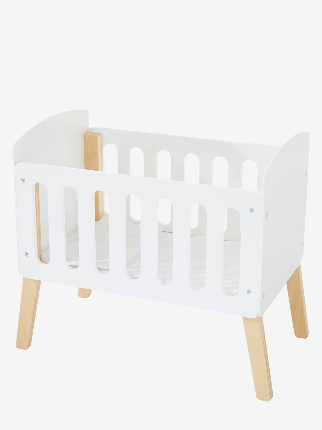 lit poupon sur pieds en bois blanc