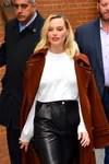 Margot Robbie walking through New York