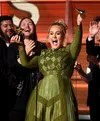 adele with green dress in the grammy-2017