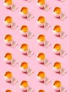 A pink background with eggs open and a yolk inside