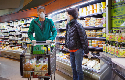 Customers wear face masks as a preventive measure against coronavirus, COVID-19,  while shopping in a supermarket in Washington…