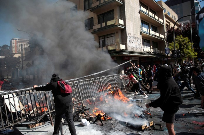 Chile's Shaken Government Makes Concessions After Protests