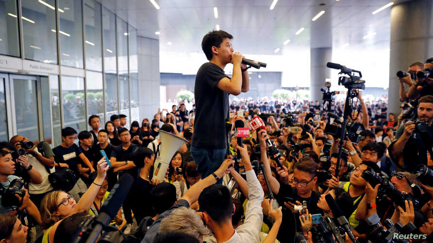 Pro-democracy activist Joshua Wong addresses the crowds outside the Legislative Council during a demonstration demanding Hong Kong's leaders step down and withdraw the extradition bill, in Hong Kong, China June 17, 2019.