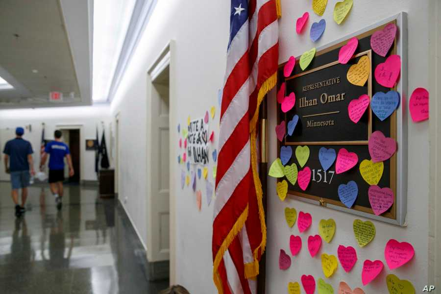 Notes line the wall outside the office of Rep. Ilhan Omar, D-Minn., Friday, July 19, 2019, part of a day-long solidarity vigil organized by anti-war protest group Code Pink, on Capitol Hill in Washington.