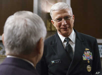 Navy Vice Adm. Craig Faller (R) talks with Senate Armed Services Committee ranking member Sen. Jack Reed, D-R.I., after a hearing on Capitol Hill in Washington, Sept. 25, 2018.