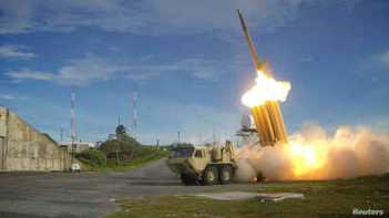 A Terminal High Altitude Area Defense (THAAD) interceptor is launched during a successful intercept test, in this undated handout photo provided by the U.S. Department of Defense.