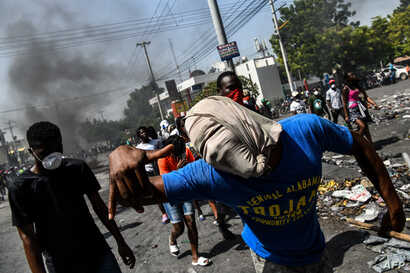 Protesters march on the street to demand the resignation of President Jovenel Moise in Port-au-Prince, Haiti on October 11,