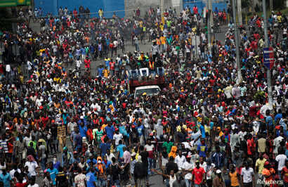 Demonstrators march during a protest to demand the resignation of Haitian president Jovenel Moise, in the streets of Port-au…