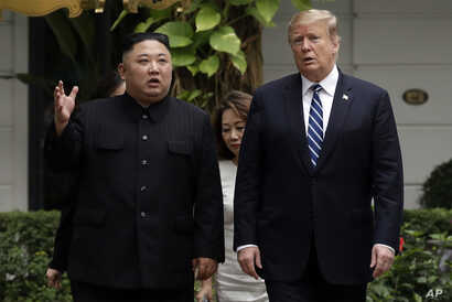 FILE - In this Feb. 28, 2019, file photo, U.S. President Donald Trump and North Korean leader Kim Jong Un take a walk after their first meeting at the Sofitel Legend Metropole Hanoi hotel, in Hanoi, Vietnam.