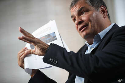 Former Ecuador President Rafael Correa talks during an interview with Associated Press in Brussels, Thursday, Oct. 10, 2019…