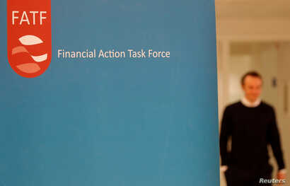 The logo of the FATF (the Financial Action Task Force) is seen during a news conference after a plenary session at the OECD…