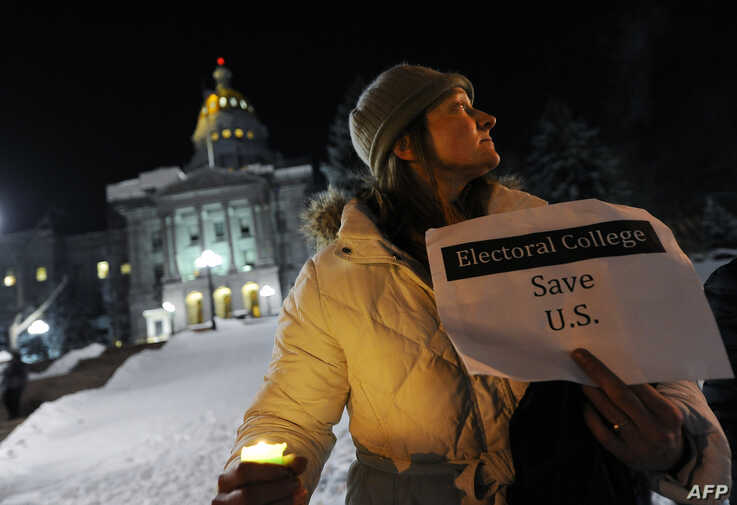 Ruth Fulton, 44, demonstrates during a candlelight vigil against US President-elect Donald Trump outside the Colorado Capitol building on the eve of the Electoral College vote, in Denver, Colorado, Dec. 18, 2016.