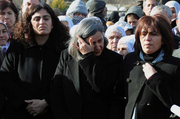Several hundred Turkish Kurds, including lawmakers Sebahat Tuncel, left, and Gultan Kisanak, center, gather to protest the killings of three Kurdish women in Paris, France, in southeastern Turkish city of Diyarbakir, Turkey, January 10, 2013.