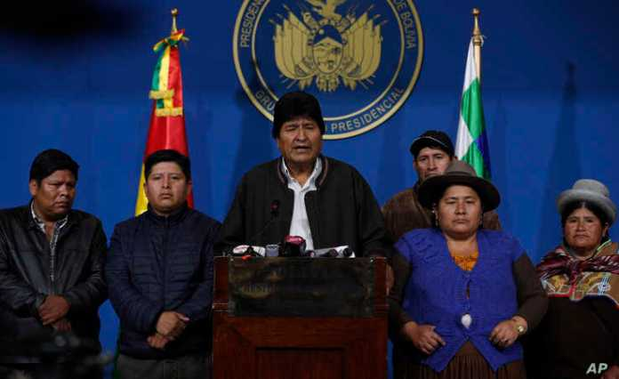 Bolivia's President Evo Morales, center, speaks during a press conference at the military base in El Alto, Bolivia, Nov. 10, 2019.
