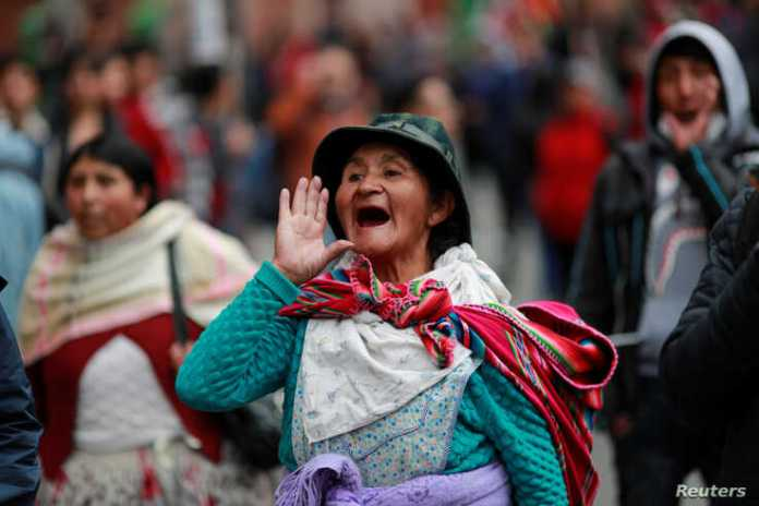 A supporter of former Bolivian President Evo Morales reacts during a protest, in La Paz, Bolivia November 14, 2019. REUTERS
