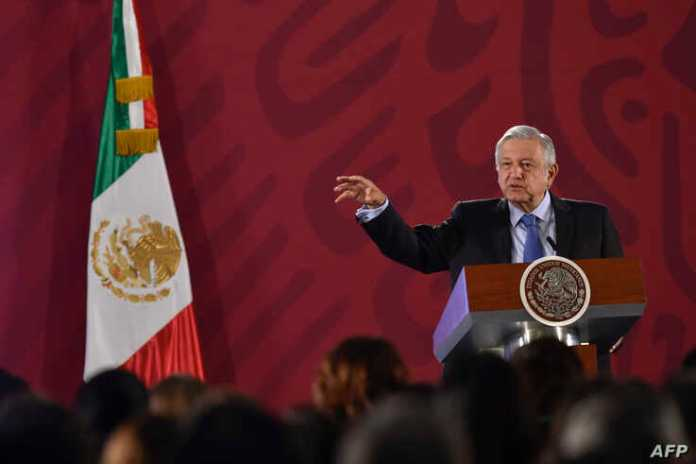 FILE - Mexican President Andres Manuel Lopez Obrador speaks during his daily morning press conference at the National Palace in Mexico City, Mexico, Nov. 21, 2019.