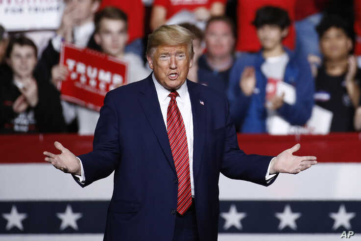 President Donald Trump walks onstage to speak at a campaign rally, Friday, Feb. 28, 2020, in North Charleston, S.C.