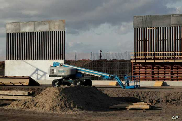 The first panels of levee border wall are seen at a construction site along the U.S.-Mexico border, Thursday, Nov. 7, 2019, in