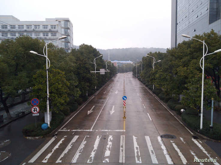 An empty street is seen in Wuhan, Hubei province, China January 25, 2020, in this picture obtained from social media. Picture…