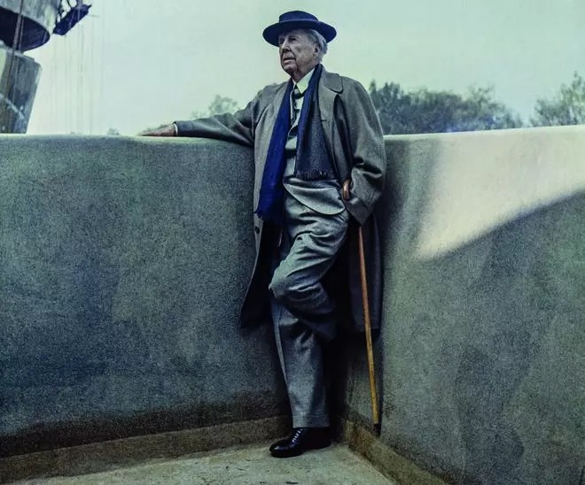 Architect Frank Lloyd Wright, on a visit to the museum, still under construction.