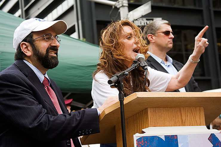 """Robert Spencer and Pamela Geller are the founders of STOP ISLAMIZATION OF AMERICA, which sponsored the rally. """"Ground Zero is a war memorial, Ground Zero is a burial ground. We are asking for sensitivity.It is unconscionable to build a shrine to the very ideology that inspired the jihadist attacks at Ground Zero, right there. There's a hair-trigger sensitivity in the Muslim world, you can't run the cartoons, you can't say Mohammed, this is offensive. This is an offensive mosque. To build a shrine, an Islamic flag of conquest on the sacred ground the cherished site, of a conquered land. This is historic, this is Islamic history. It's what they do. The St. Sofia in Turkey , the al-Quds, at the holiest Jewish site in Israel . Not here. This is where we take a stand. We must take a stand. We must say no.""""  (Pamela Geller)"""