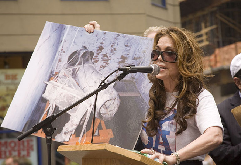Pamela Geller organizer of June 6 rally holds photo of plane parts