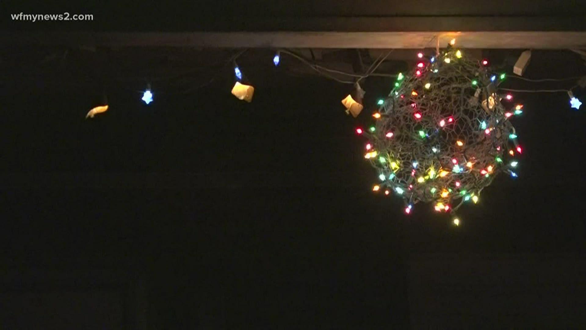 greensboro neighbors hanging christmas lights in spring