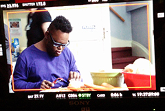 JT, John Tucker plays Big D, a funny guy with a big attitude, seen here working on his independent skills, pealing potatoes.