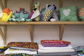 Shelves of fabric and past projects at the Sew Fun Studio.</p>