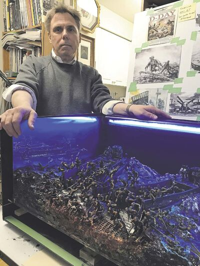MARTIN ZEILIG PHOTO</p><p>Darryl Audette poses beside his diorama of a D-Day scene that will be on display at an exhibition at the St. James Legion this weekend.</p>
