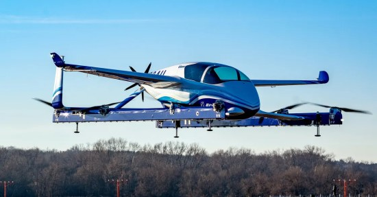 Boeing flying car in air at testing track.