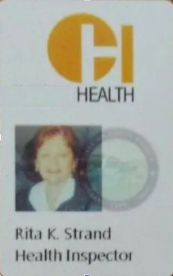 a woman counterfeit health inspection ID