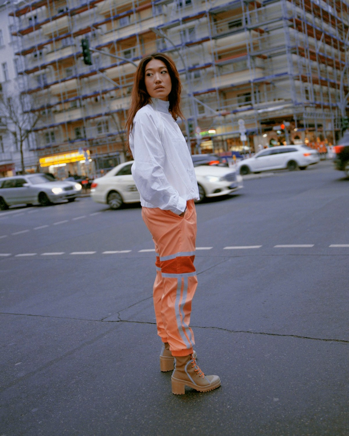 South Korean DJ Peggy Gou on the cover of Rollacoaster Spring/Summer 2019 orange trousers