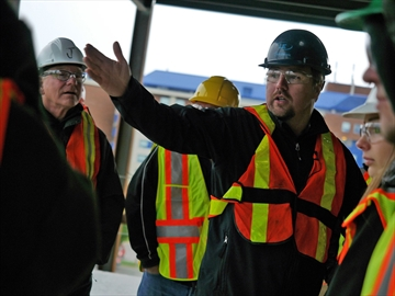 Brian Westermann, a board member of the Barrie Construction Association, gives Barrie North Collegiate Institute students a tour of a worksite at Georgian College and explains what part different tradespeople played in the construction of the building.