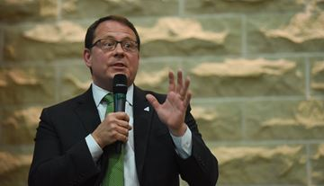 Guelph MPP and Ontario Green Party leader Mike Schreiner has unveiled new stickers that gas stations will be free to use. The stickers, he says, lay out what non-action on climate change will cause.