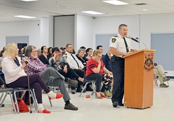 Midland Police Chief Michael Osborne responds Sept. 6 to comments raised by residents. Council later decided to disband the MPS in favour of the OPP.